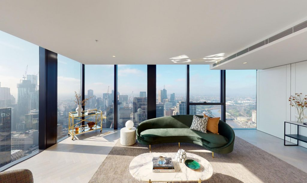 Living area with expansive windows and city views