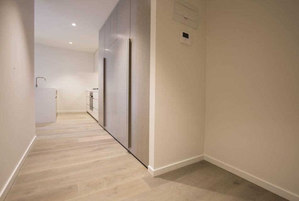 Empty hallway leading to kitchen