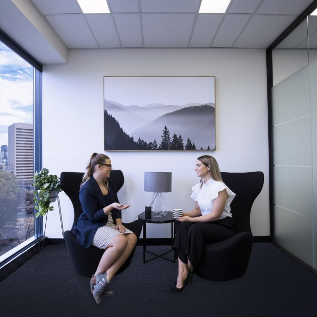 Two people in an office talking