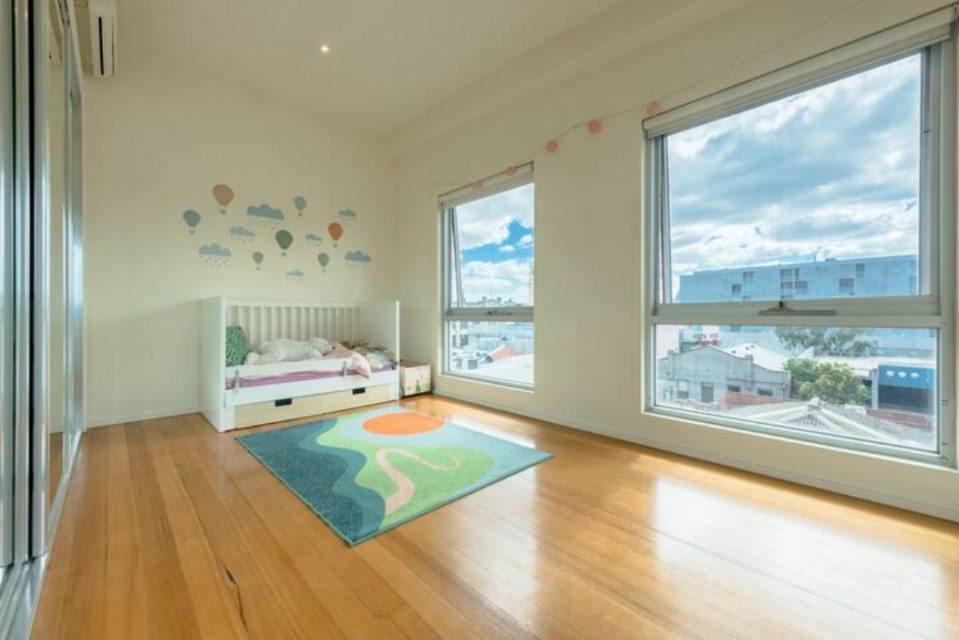 Children's room with colourful rug