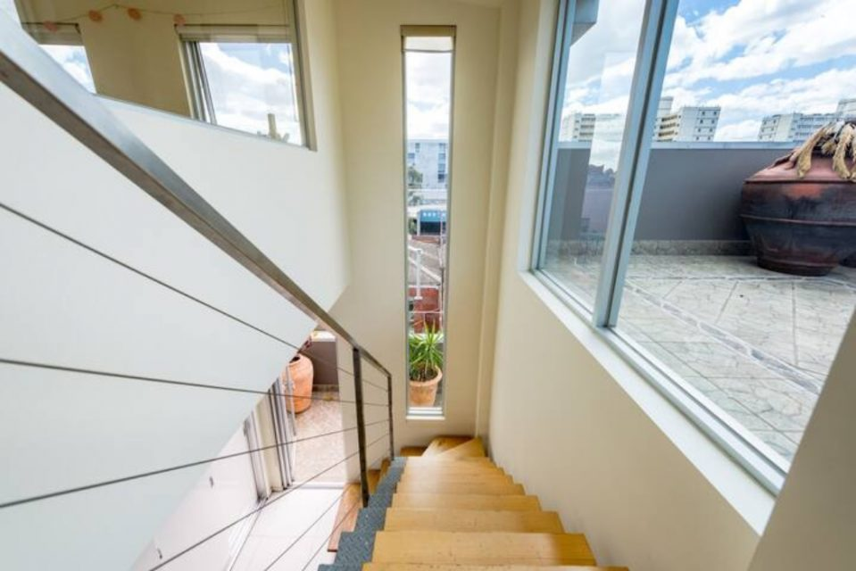 Stairs with windows adjacent